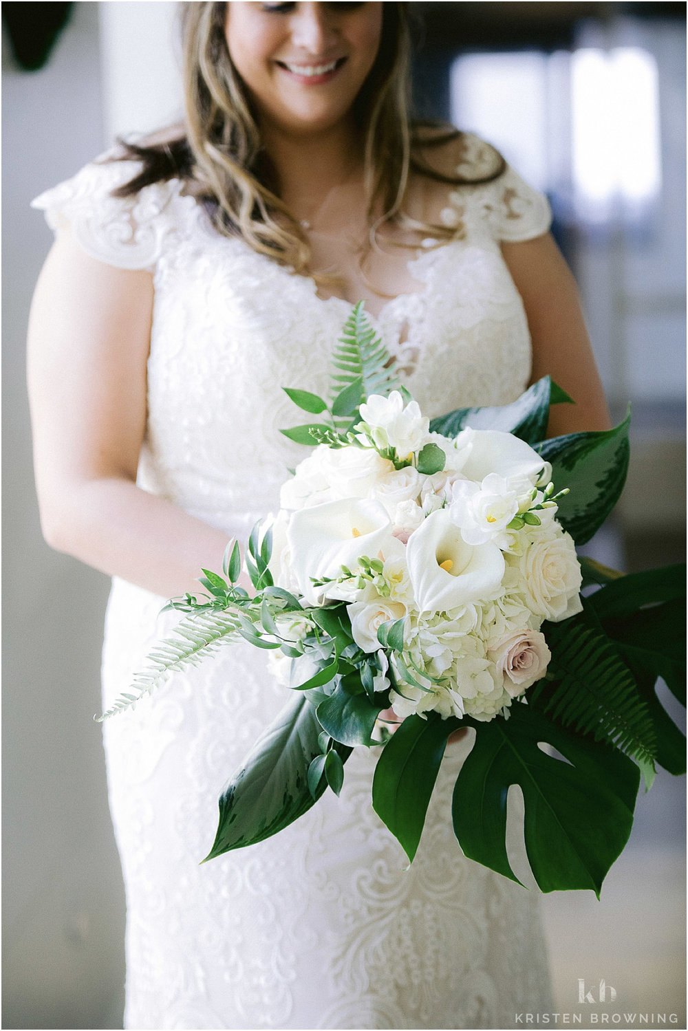 Hutchinson Shores Resort and Spa Bride holding polished petals bouquet