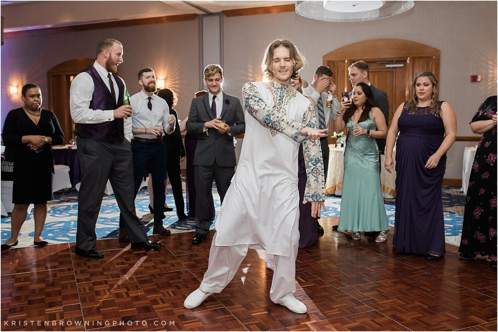 Groom dancing at wedding Hilton Double Tree