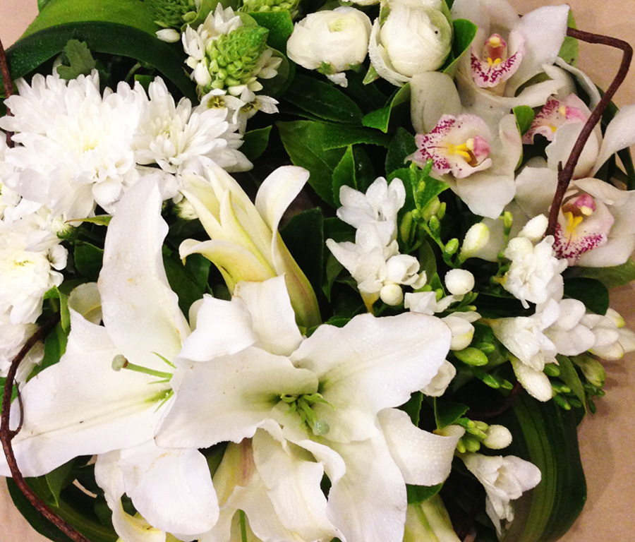 white lillies and orchids