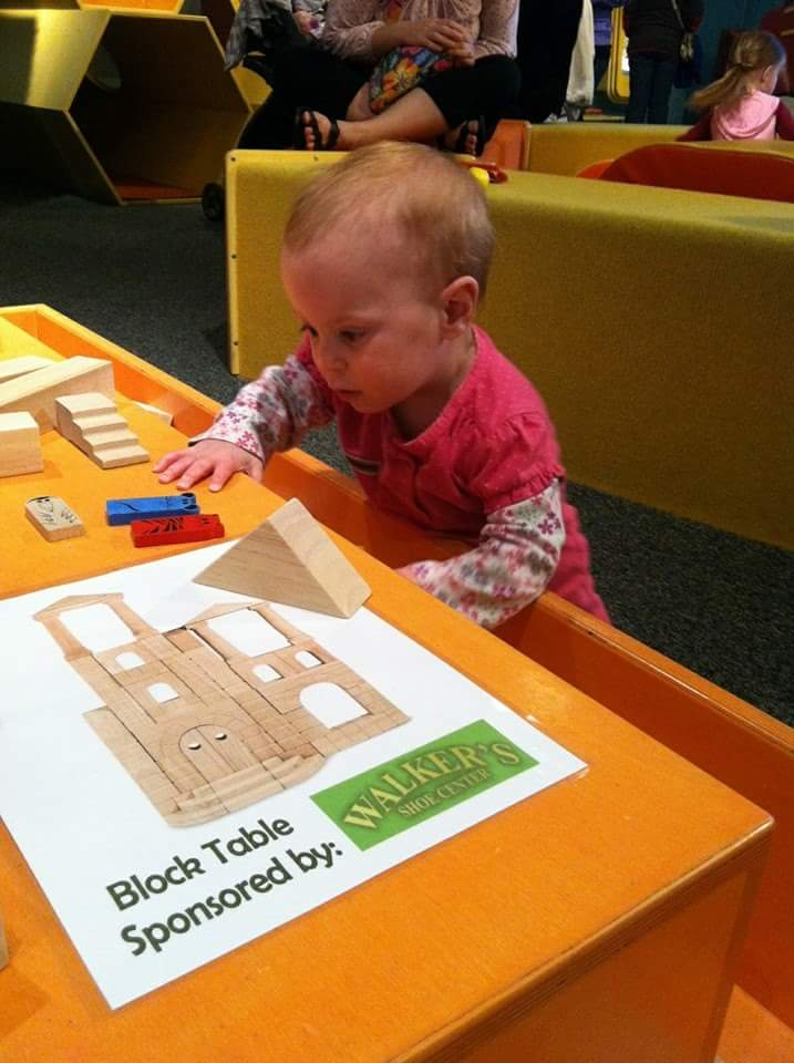 BLOCK TABLE  Little architects will find our wooden blocks lead to all kinds of buildings and structures.   Block Table Sponsored by Walker's Shoe Center