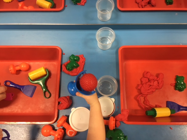 SENSORY TABLE  A STEAM Zone favorite! Little hands roll play dough, scoop instant snow, squish shaving cream and water beads with changing sensory activities.   Funded by a grant from the Cordle Cares Foundation