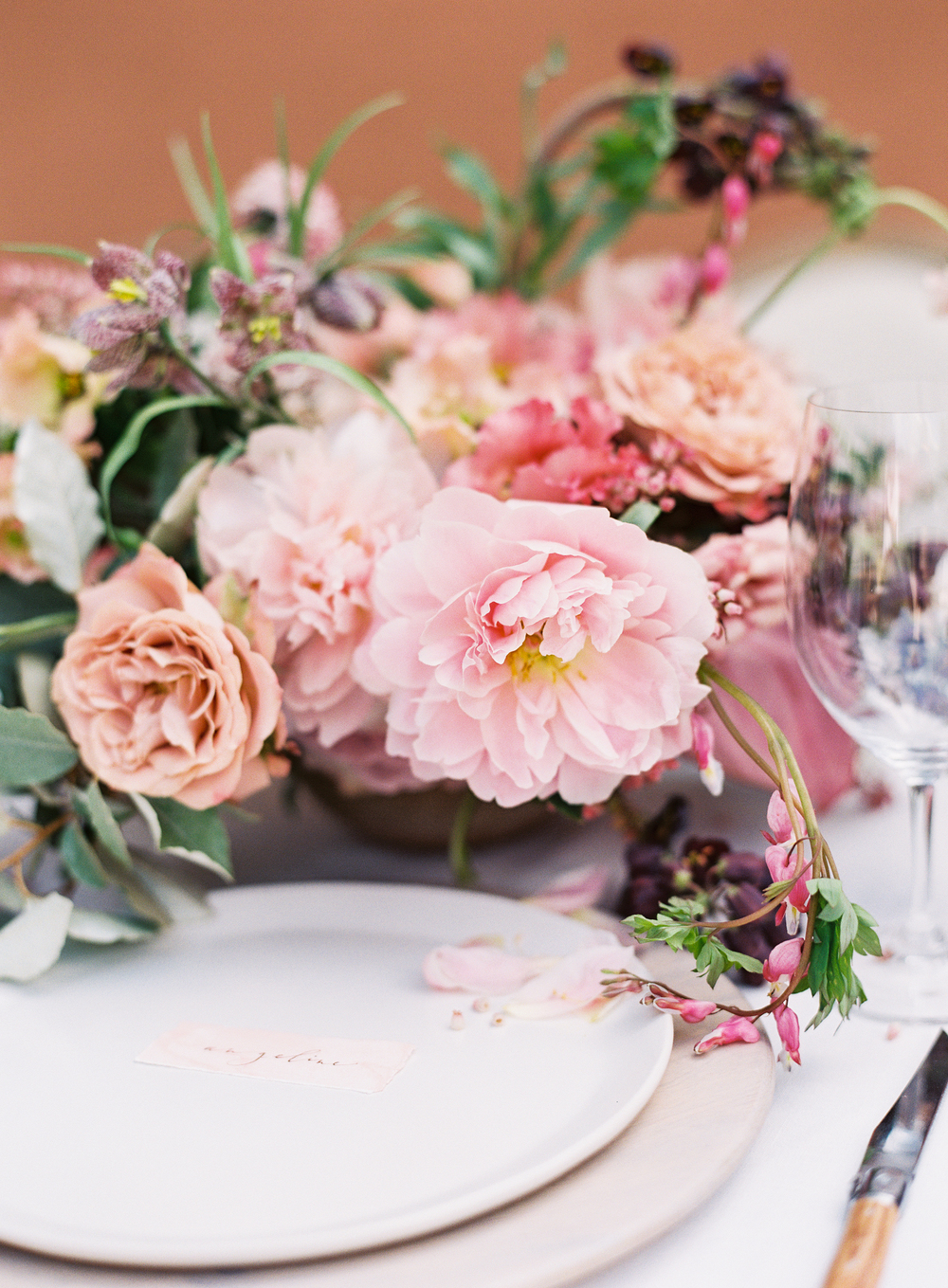 terracotta pink flowers and table setting | terracotta pink wedding inspiration designed by The Wildflowers | follow us on instagram: @ thewildflowers.events