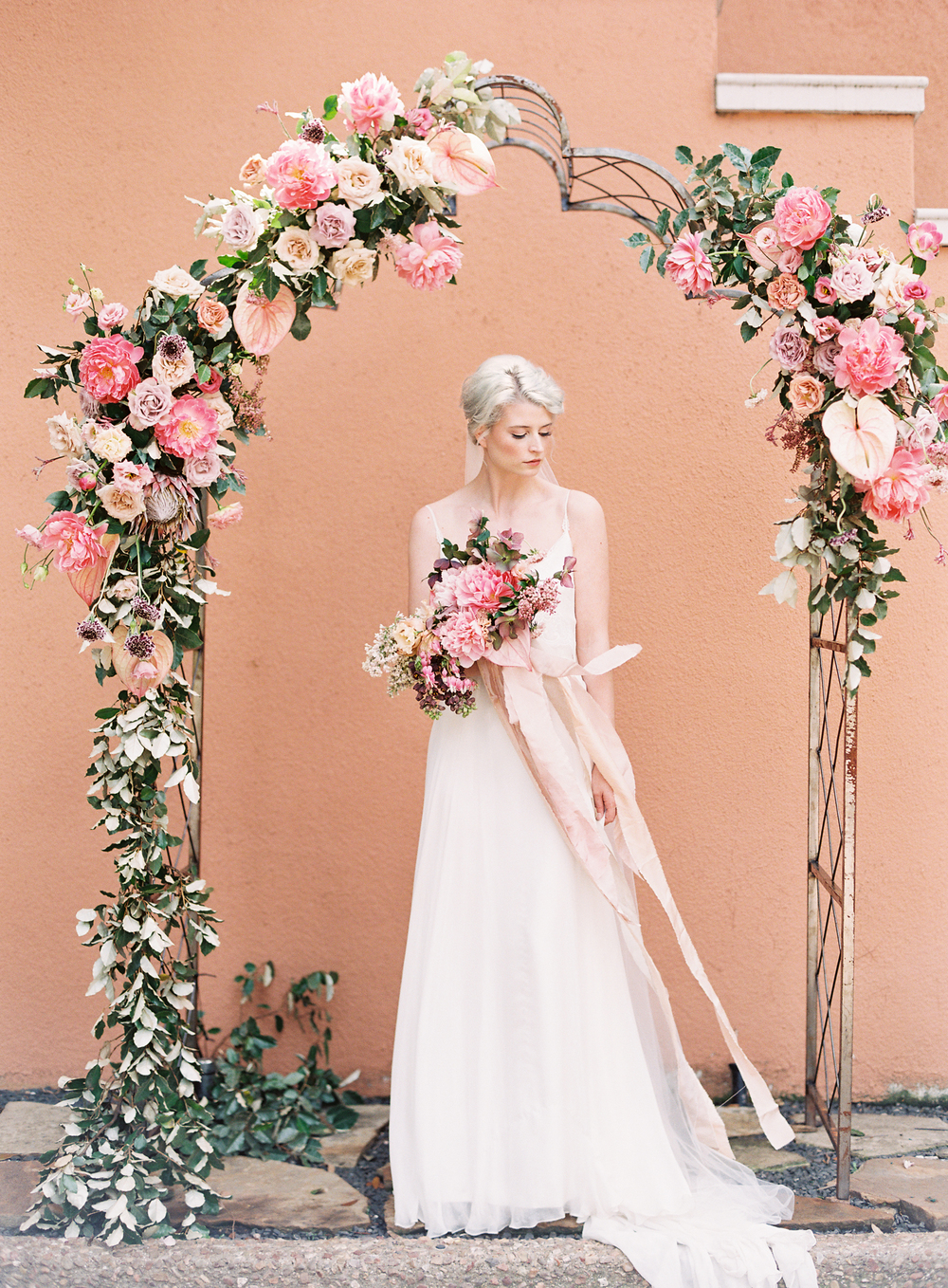 wedding arch | terracotta pink wedding inspiration designed by The Wildflowers | follow us on instagram: @ thewildflowers.events