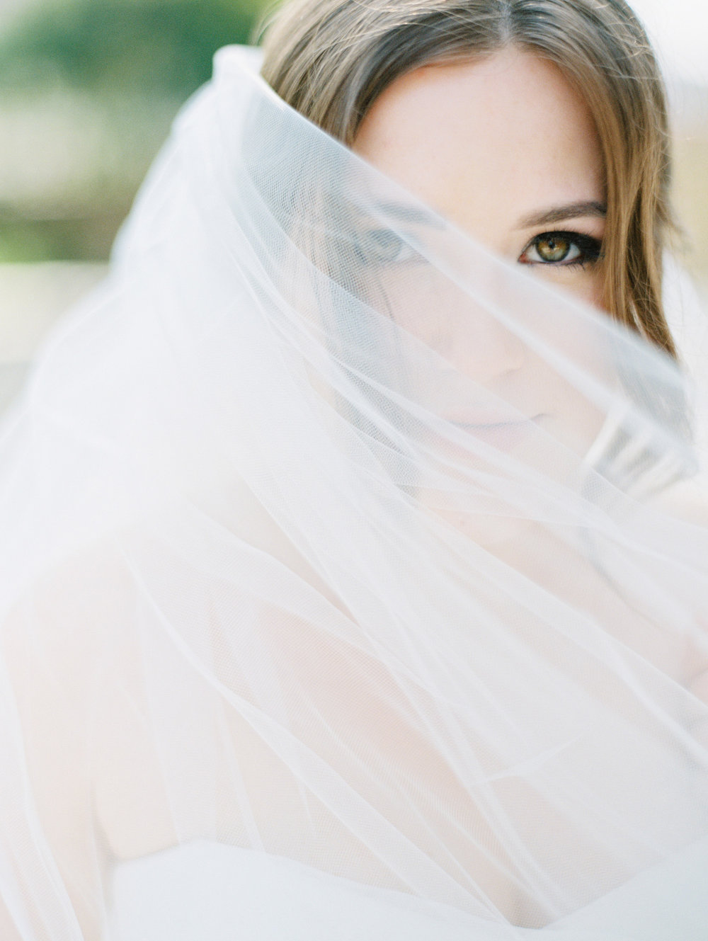 A barely-there veil offers the smallest bit of mystery to this bride's allure. | The Wildflowers featured on Martha Stewart Weddings | Instagram: @ thewildflowers_com | www.thewildflowers.com