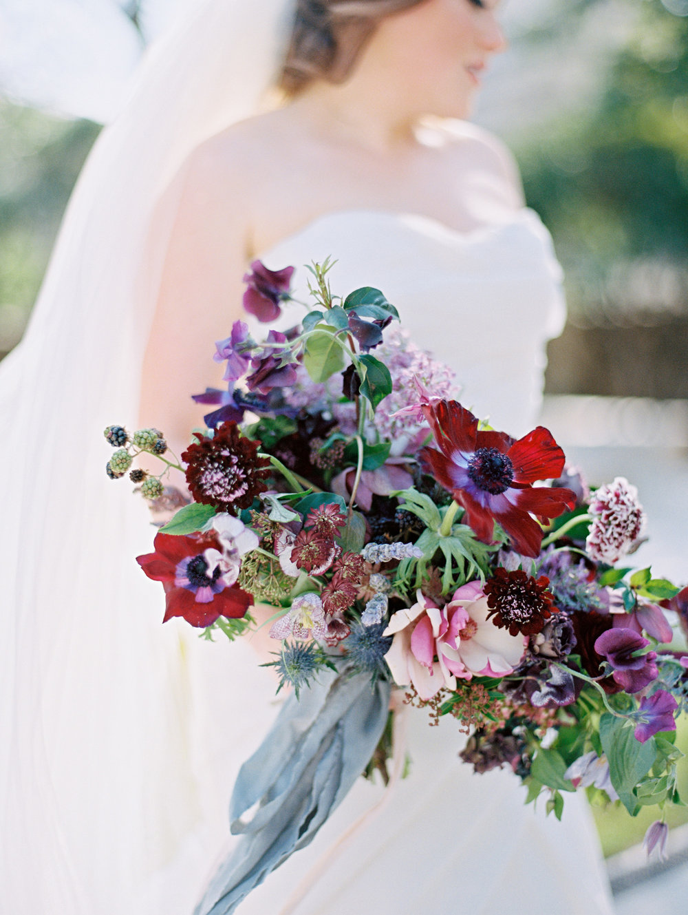 A knockout bouquet of draped, just-gathered florals in dark purples, pinks and reds. | The Wildflowers featured on Martha Stewart Weddings | Instagram: @ thewildflowers_com | www.thewildflowers.com