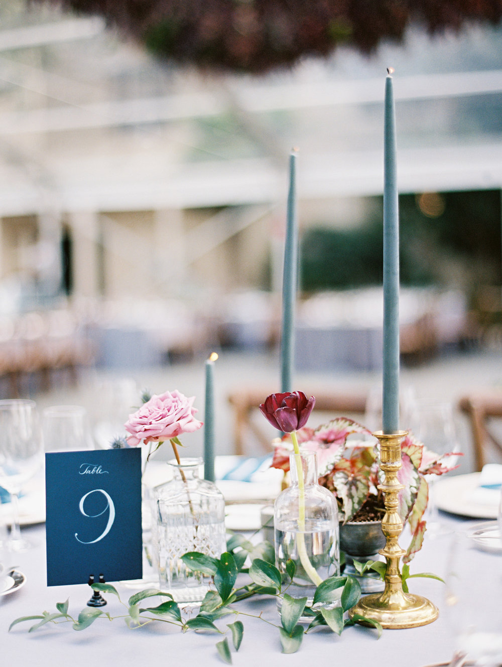 Individual flowers occupy little crystal vases on this tablescape. | The Wildflowers featured on Martha Stewart Weddings | Instagram: @ thewildflowers_com | www.thewildflowers.com