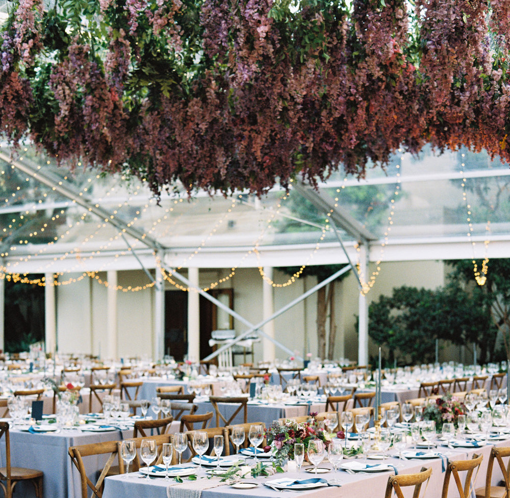 Dyed freesia envelops guests in a whimsical floral canopy. | The Wildflowers featured on Martha Stewart Weddings | Instagram: @ thewildflowers_com | www.thewildflowers.com