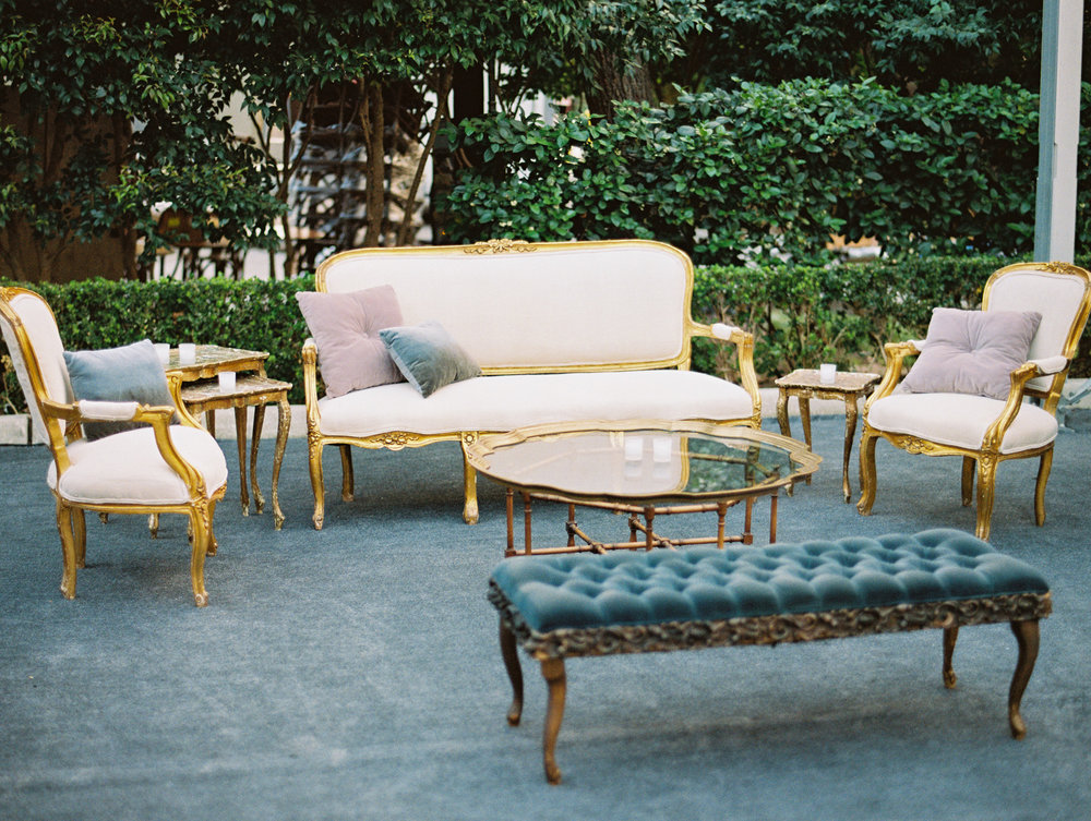 Vintage chaises and metallic accents create a chic dance floor seating area. | The Wildflowers featured on Martha Stewart Weddings | Instagram: @ thewildflowers_com | www.thewildflowers.com