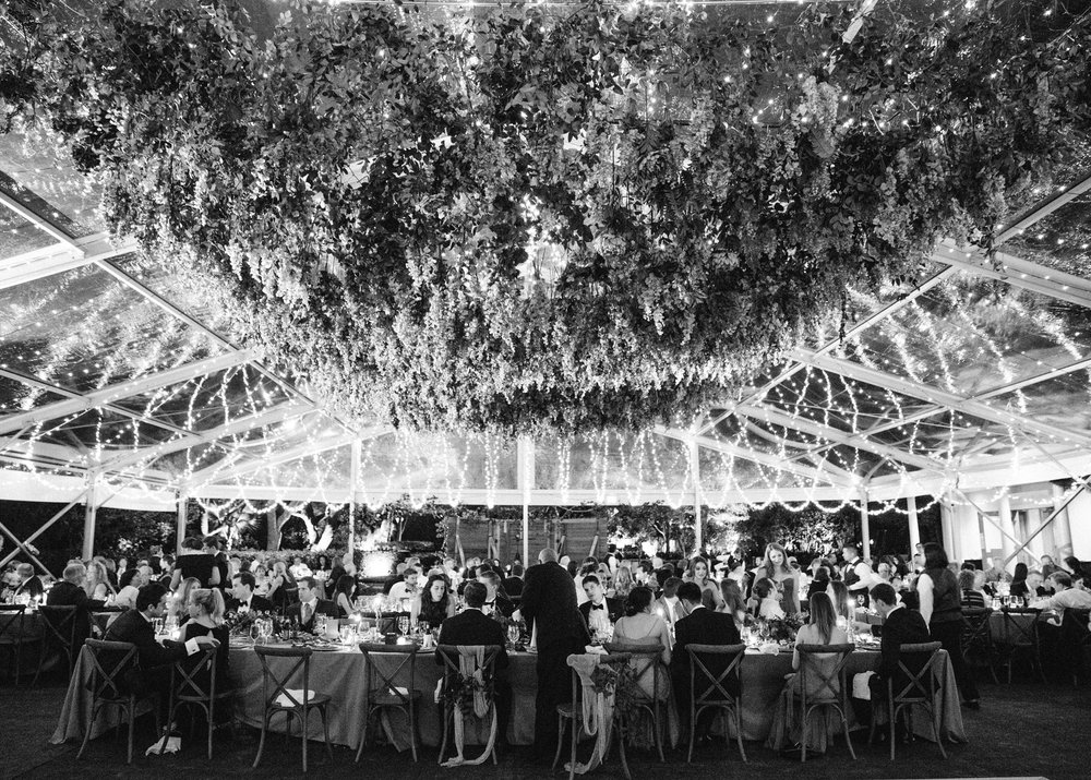 Even in black and white, this freesia installation and twinkling lights are breathtaking. | The Wildflowers featured on Martha Stewart Weddings | Instagram: @ thewildflowers_com | www.thewildflowers.com
