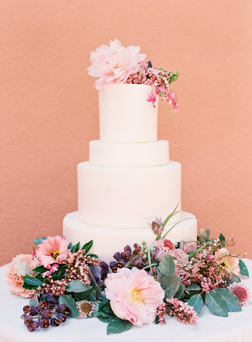 Organic, terra cotta pink wedding inspiration featured in Ruffled