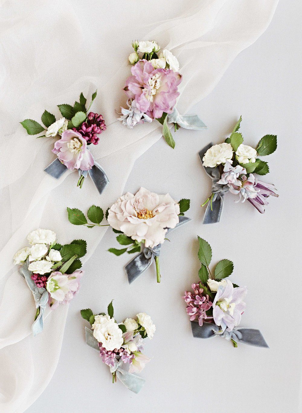 rebecca-clay-wedding-north-carolina-boutonnieres-103228791.jpg