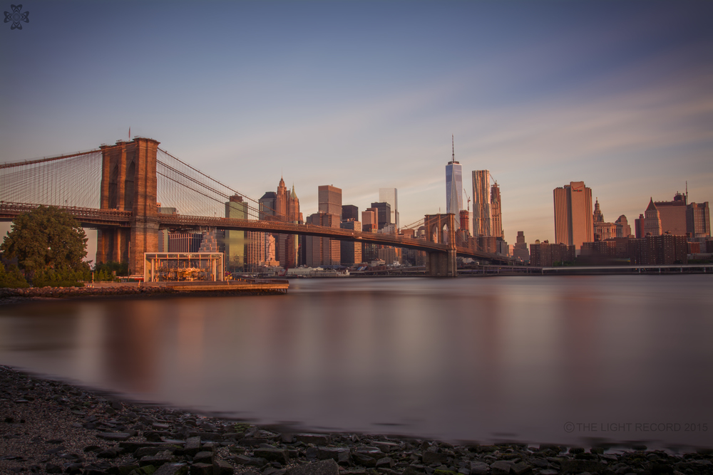 A long exposure taken at sunrise from Brooklyn shows the new skyline perspective from the East.