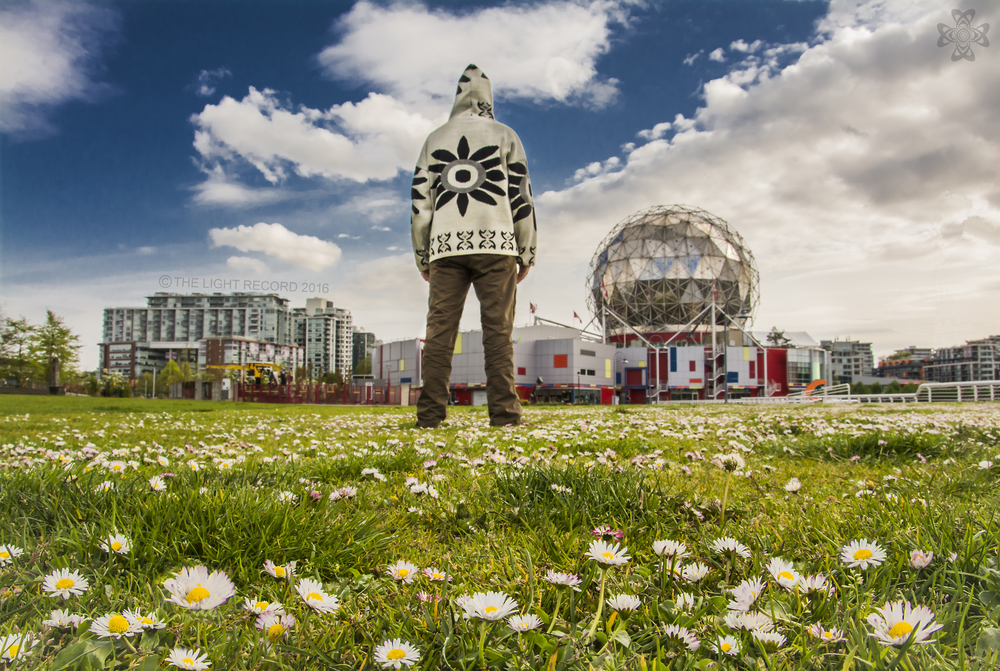 Auto Portrait  Small wildflowers provide a lovely foreground to the Vancouver Science Centre and its iconic globe.