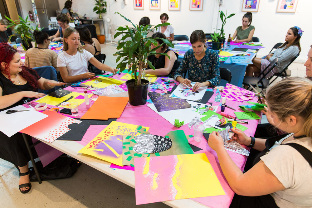 Participants working on colourful patterned collages