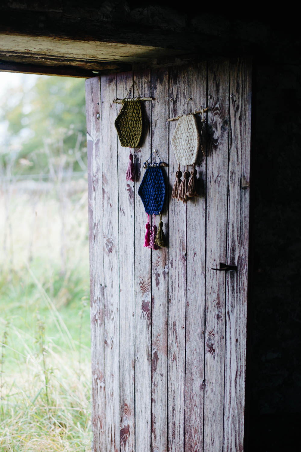 crochet hexagon wall hangings by Kat Goldin