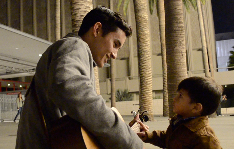 Snow connecting with a young admirer on the streets of L.A. during a music video shoot in 2015