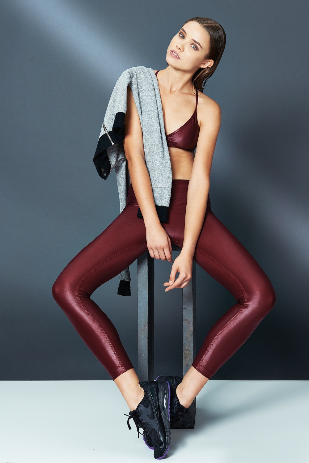 Koral Activewear Grip Sports Bra in Ruby, Verso Sweater in Heather gray/black, Lustrous Legging in Ruby