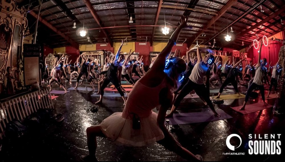 Kate Kendall leads Flow Athletic devotees through Silent Disco Yoga Moves