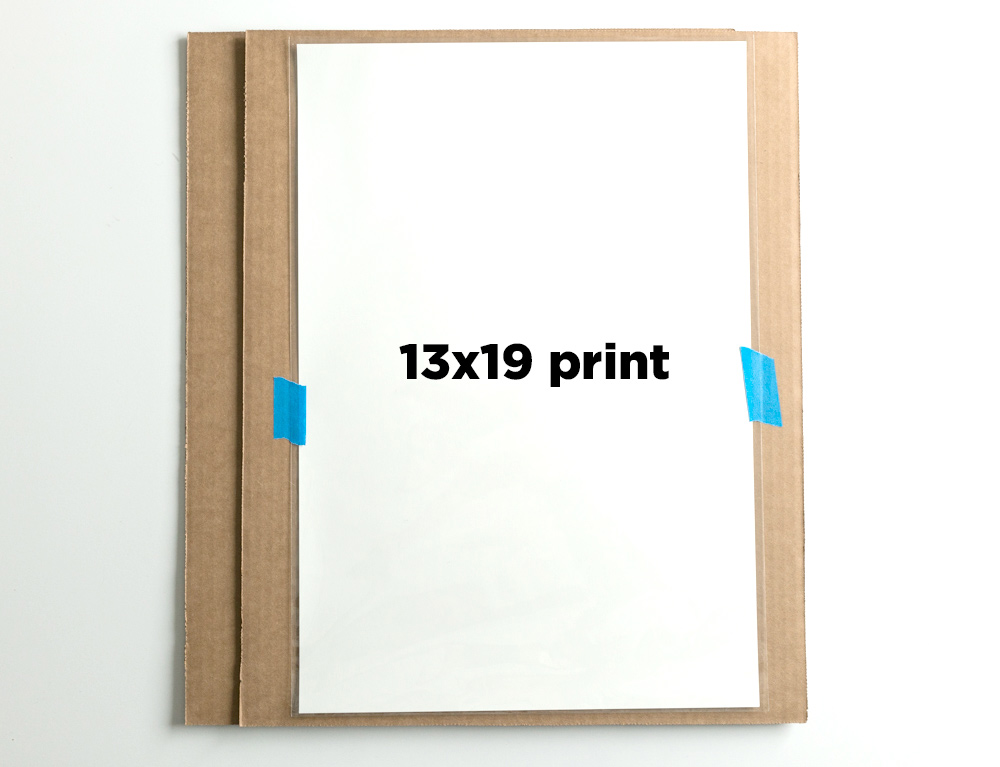"""Example:  Sleeved 13x19"""" print, centered and affixed to the cardboard backer sheet."""