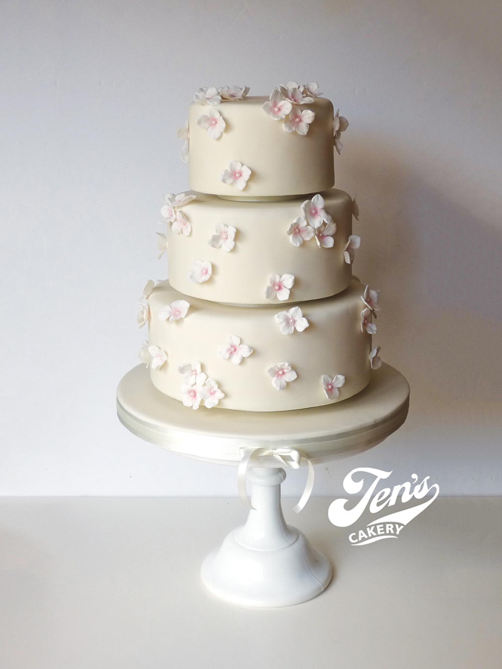 With no large floral arrangement on the top tier, as shown here, Jessica falls into  Price Band A .