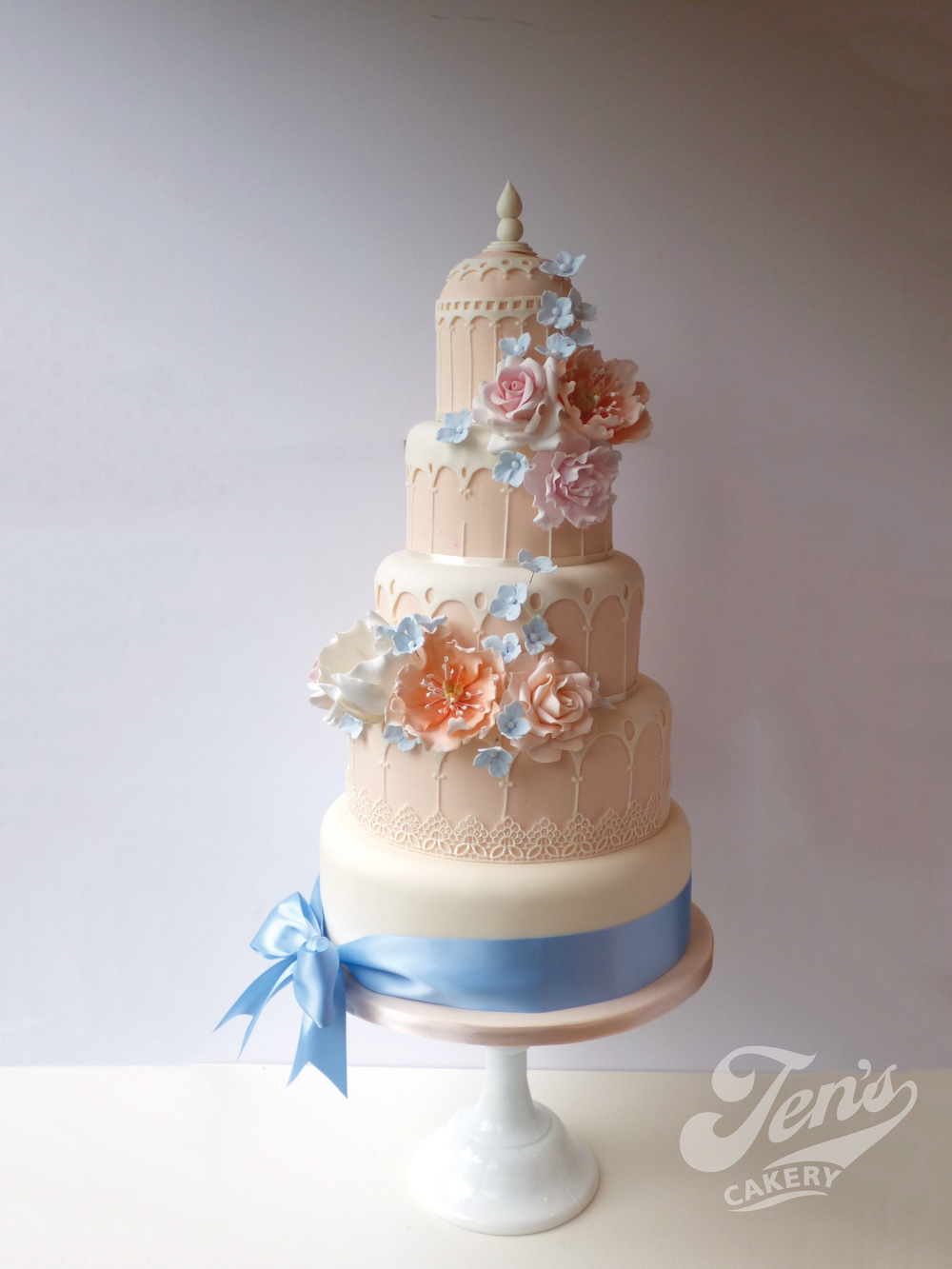 Elegant blush and powder blue version of Maya, a wedding cake based on Syon Park Great Conservatory