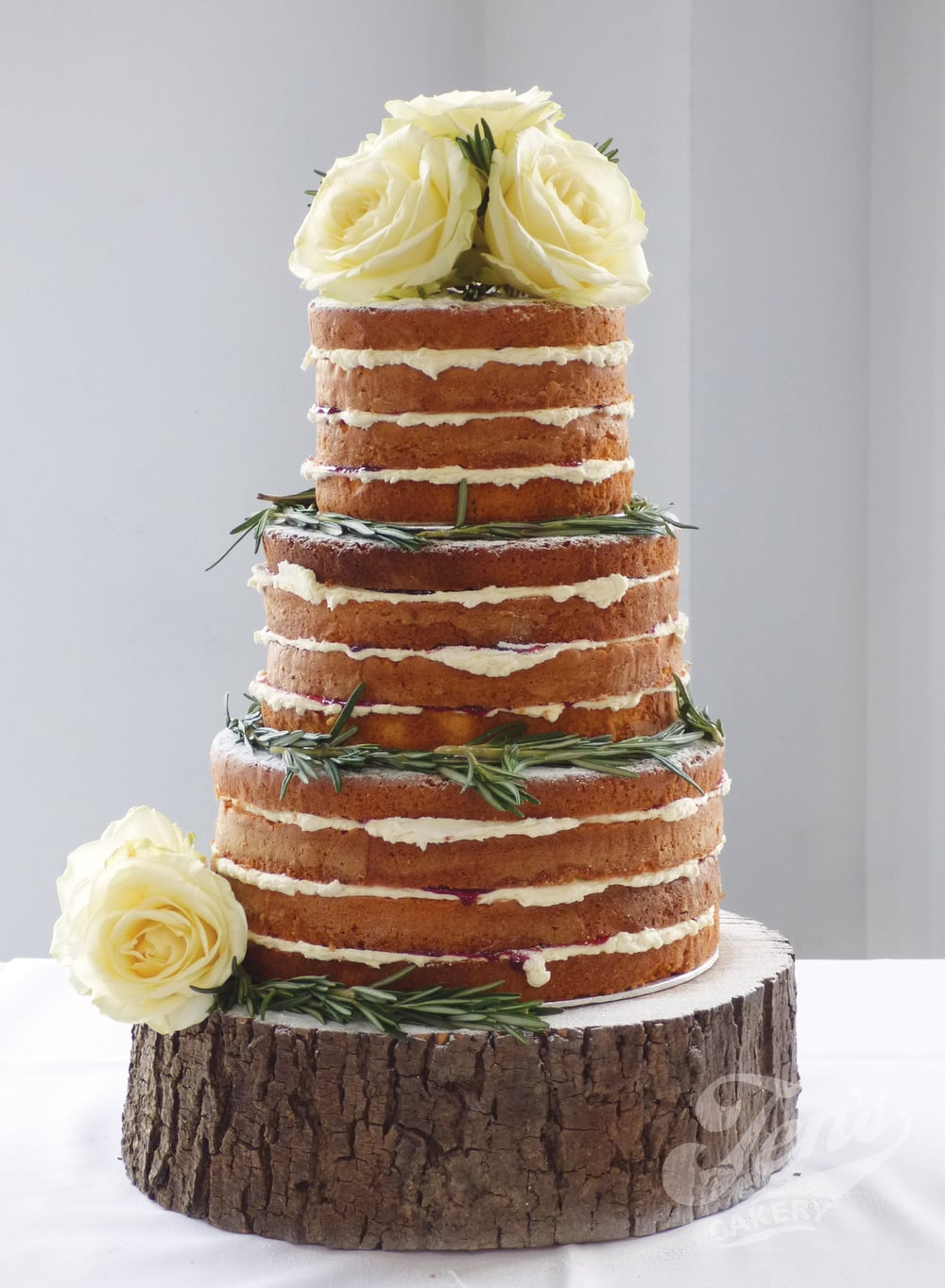 This naked cake looks beautiful with just sprigs of rosemary and fresh roses.
