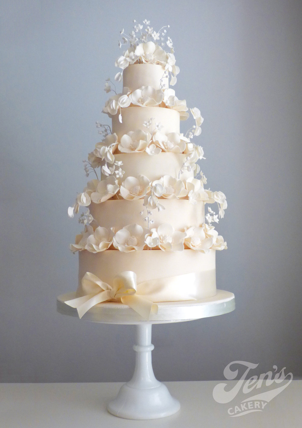 Beautiful ivory wedding cake with flowers giving just the right balance between modern and traditional.