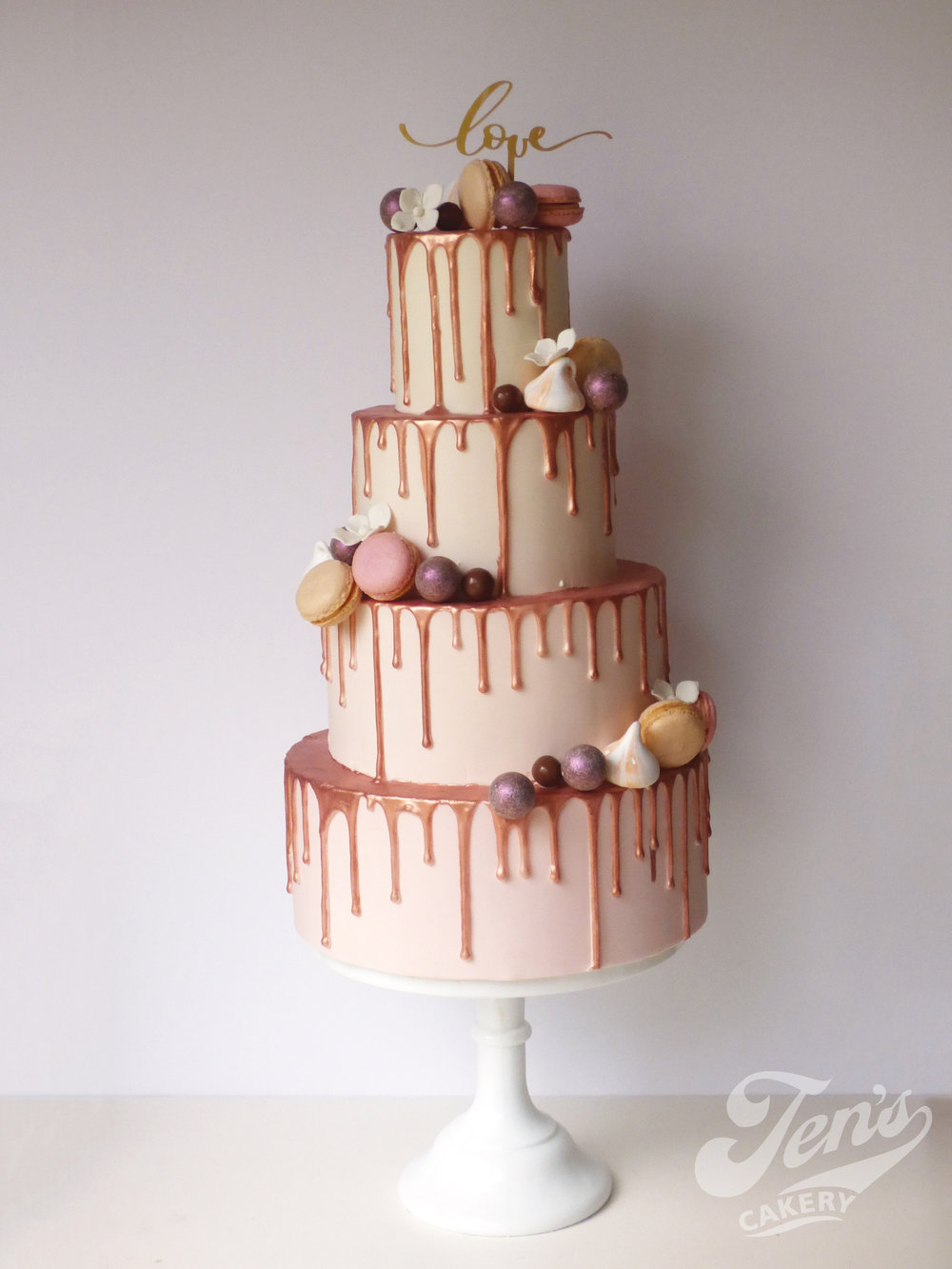 Drip wedding cake with rose gold metallic drips!