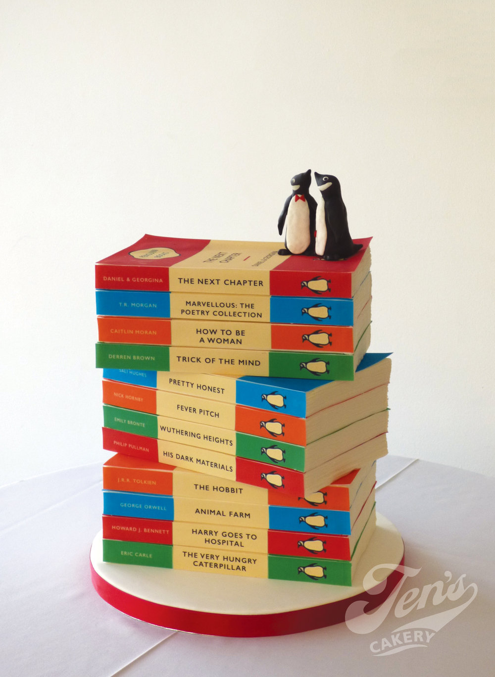 An illusion wedding cake that looks like a pile of penguin classic novels, perfect for book lovers! Here in the garden room at Hampton Court Palace.