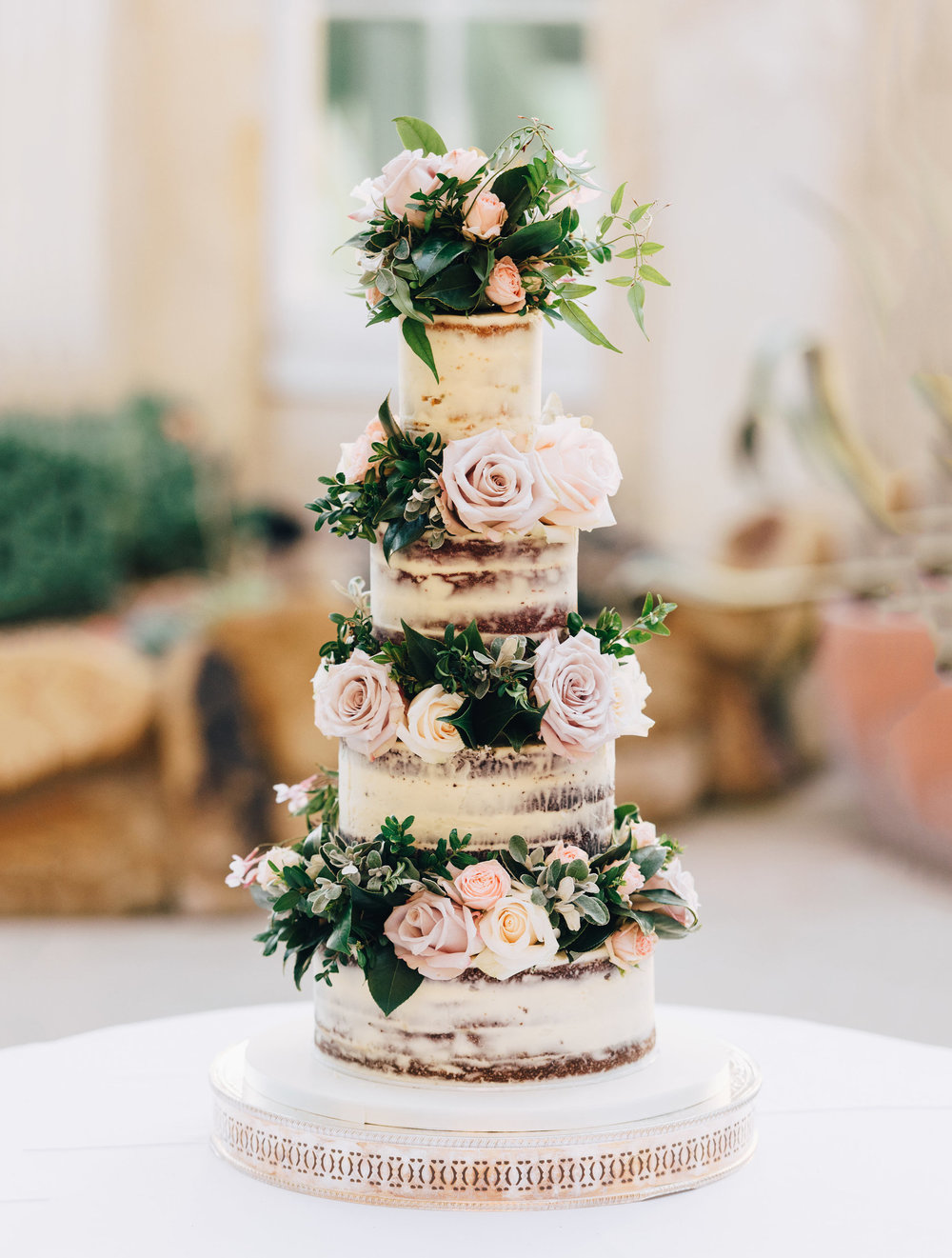 Photo credit:  Will Patrick  Naked and semi-naked wedding cakes are our speciality for rustic weddings, or tight budgets.