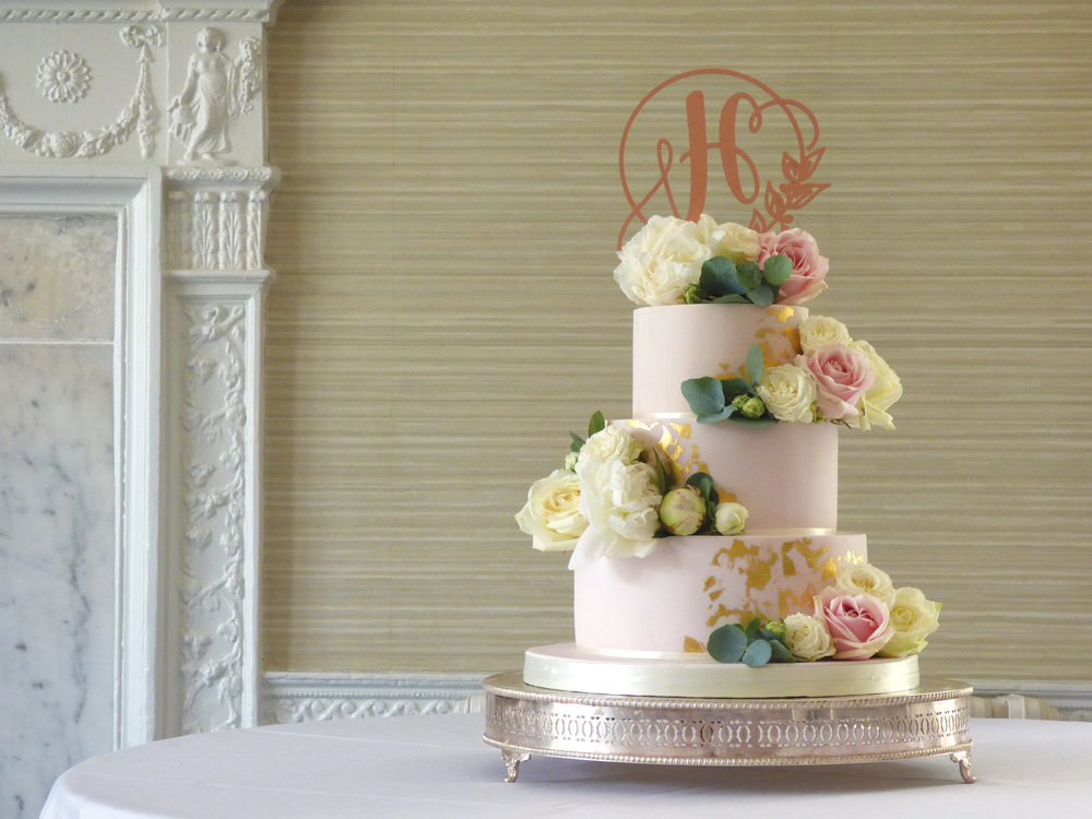 wedding cake with gold leaf with fresh flowers and blush pale pink icing, at Morden Hall