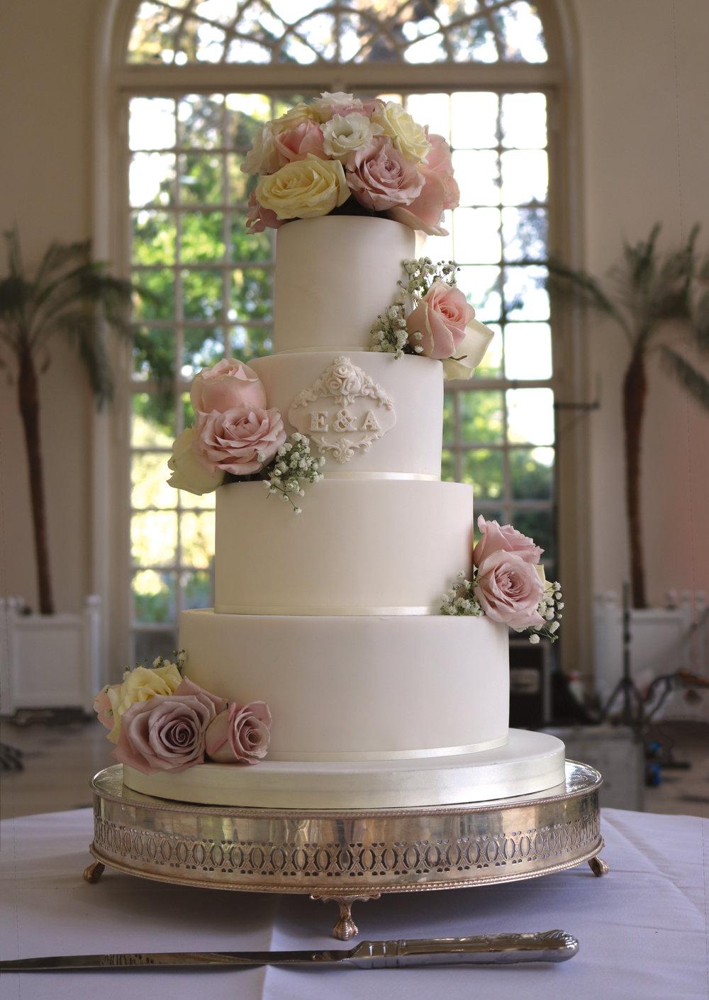 Elegant monogrammed wedding cake at Kew Gardens Orangery in West London