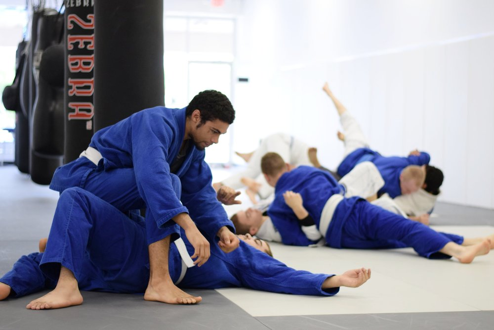 White belts drilling techniques during a beginner class