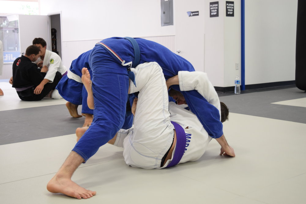 Practicing open guard during advanced class
