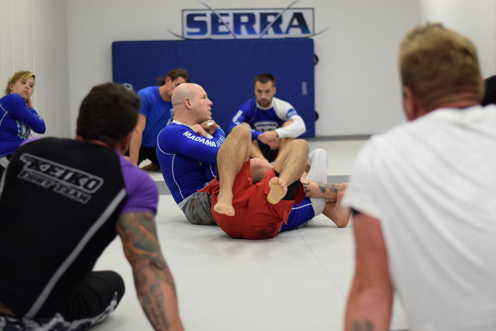 Professor Madama teaching arm locks in Advanced No-Gi Class