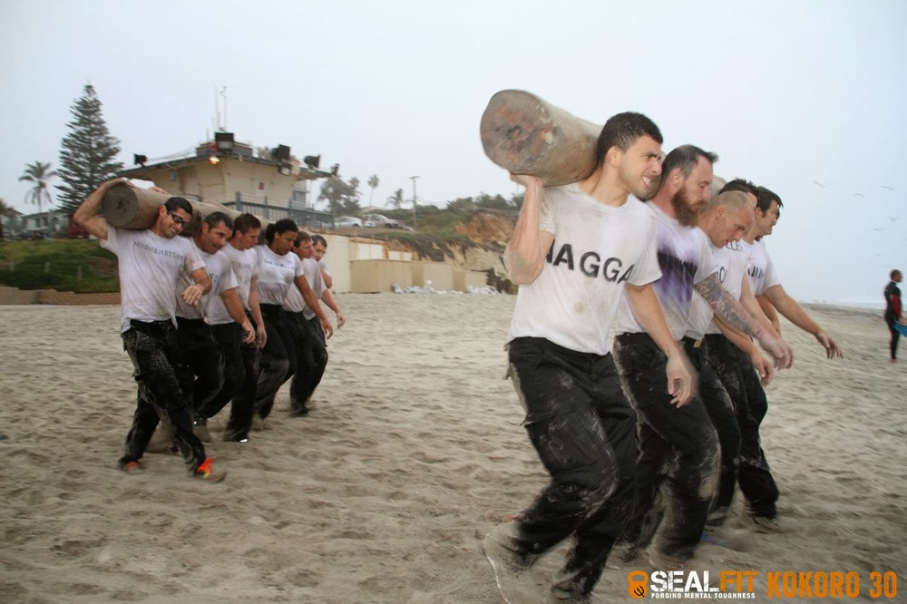 Log PT in the surf at SealFit Kokoro 30