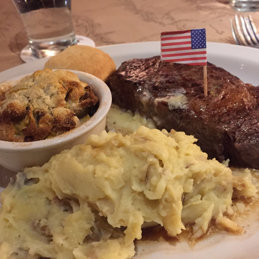 Bison Ribeye, Mashed Potatoes and squash casserole with an American Flag on top.  I love Montana