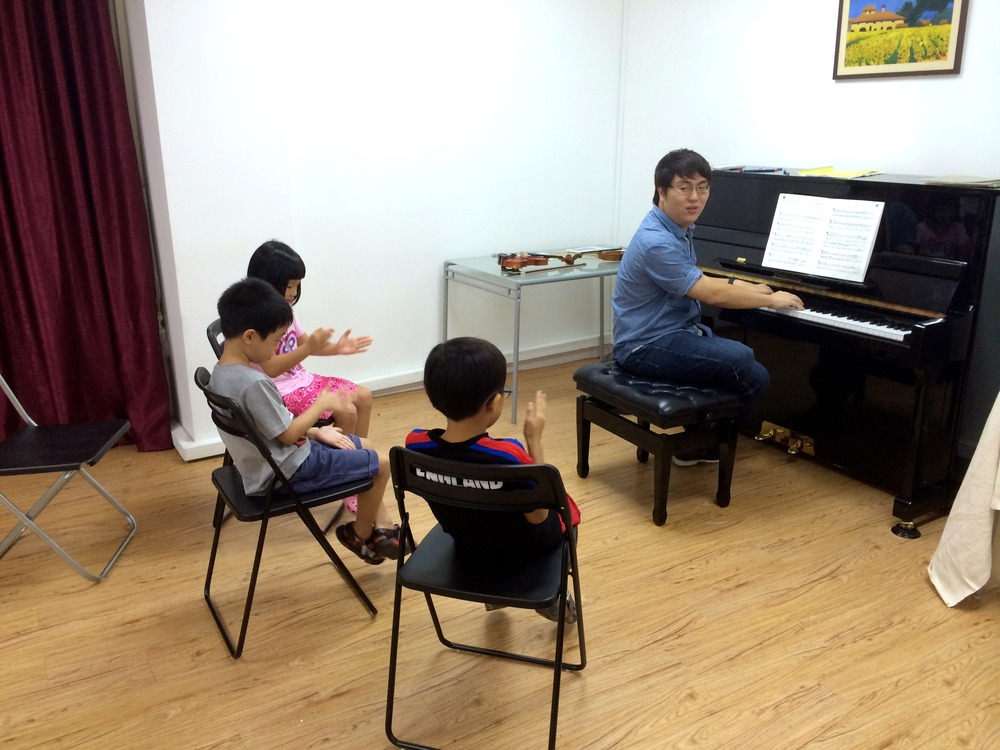 Teacher Wei Yang going through the different components of the Aural Tests with students