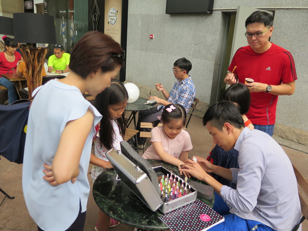 The multi-talented Yong Jie, a familiar face at The Music Suite, applying glitter tattoos for the kids!