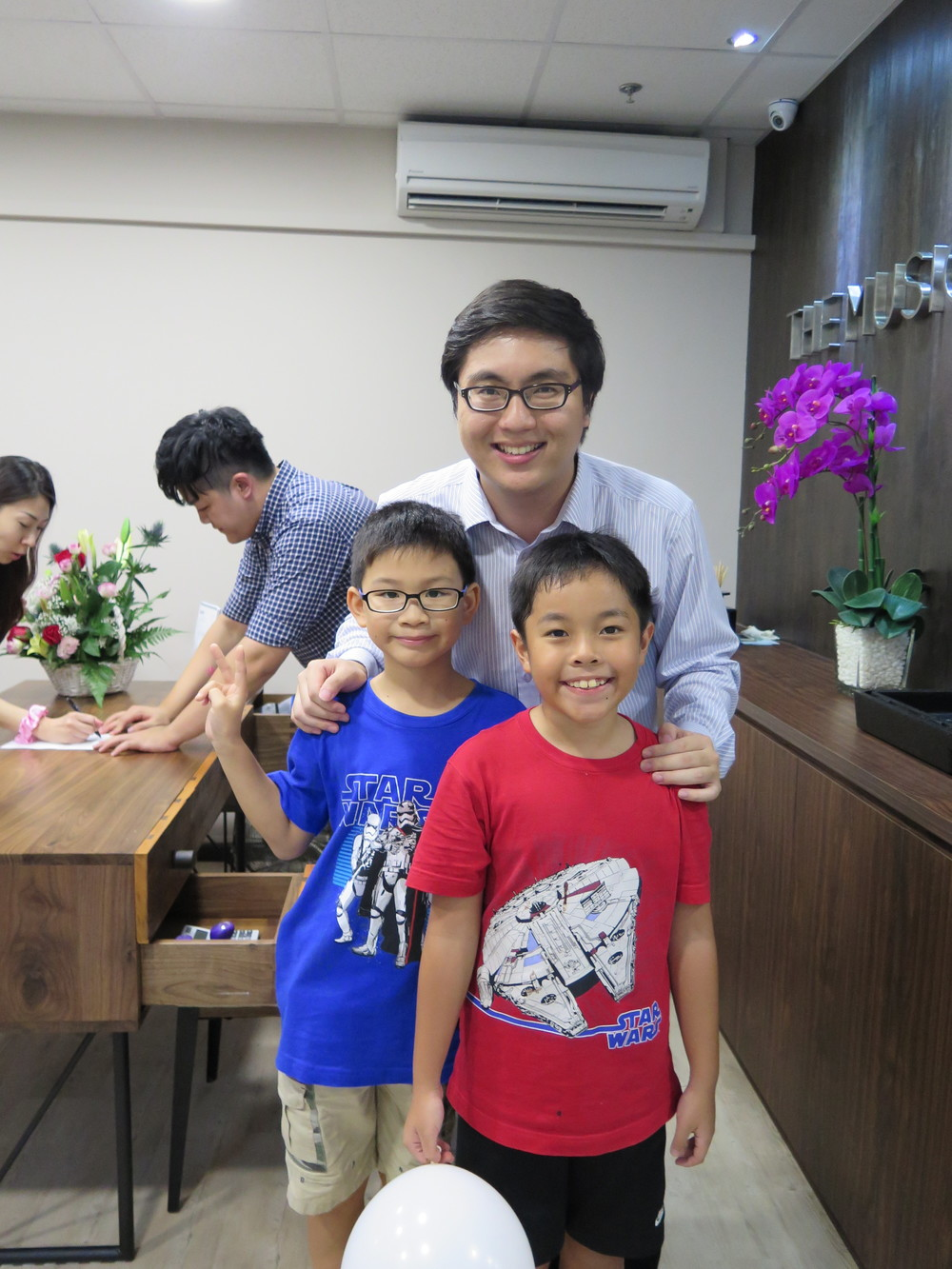 Teacher Wei Yang with his students Matthew and Samuel. Teacher Jeremiah pictured in the background busy as usual