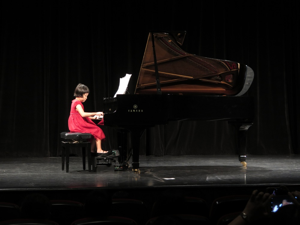 and Yun Hui on the piano and her piano pedal extender after her wonderful emceeing!