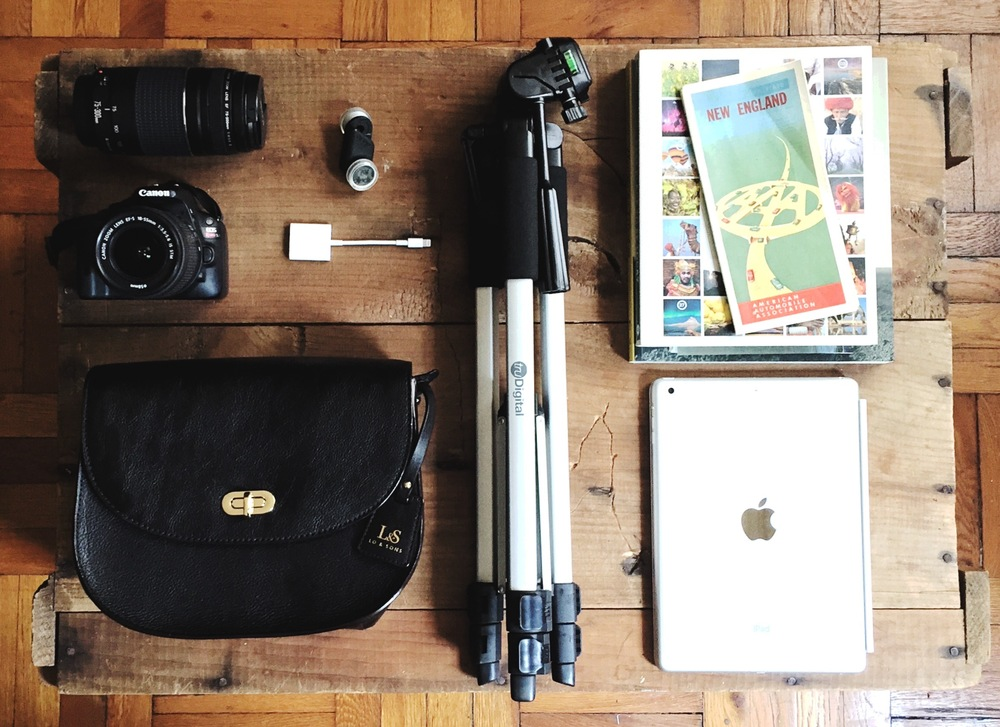 (Clockwise) Canon camera and lens,  Lo & Sons  Claremont bag, truDigital tripod, Apple iPad Air,  Ollo Clip  iPhone Lens,  Apple Lightning to SD Card Reader