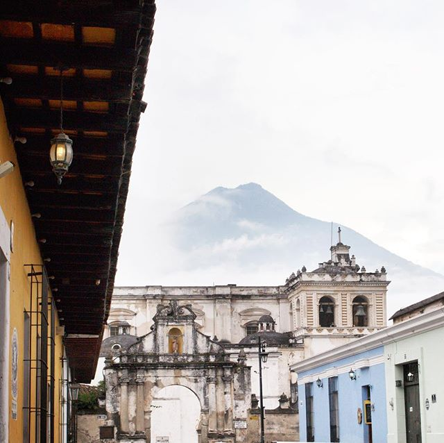 May is the start of rainy season in #Guatemala and that made shooting around Antigua a fun challenge. I never knew when I would next catch a glimpse of Volcan de Agua in between the mist and clouds, looming above the city.