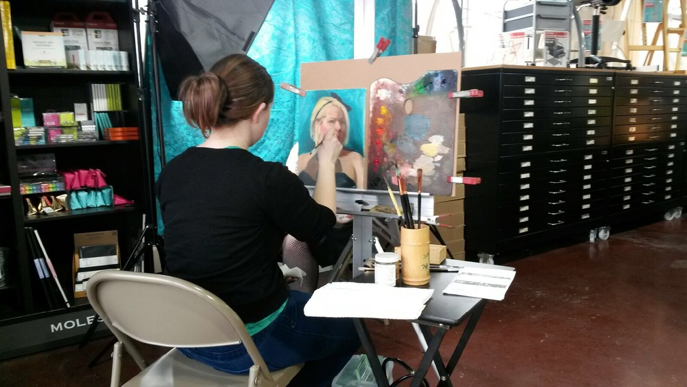 Lacey Lewis painting a portrait at Blick Art Materials