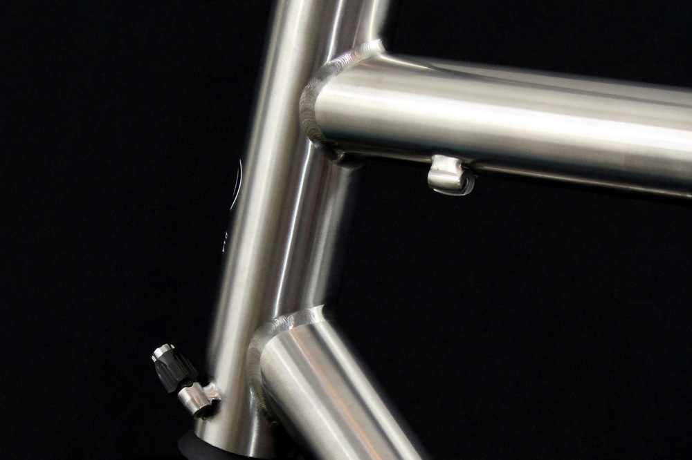 Titanium road with Touring Package in raw polished titanium finish.