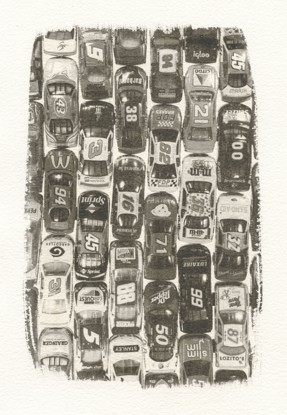 """Matchbox Cars,""  Silver Gelatin Emulsion on Arches Watercolor Paper, Toned in Sepia.  at Penny Cluse Café, February 2019"