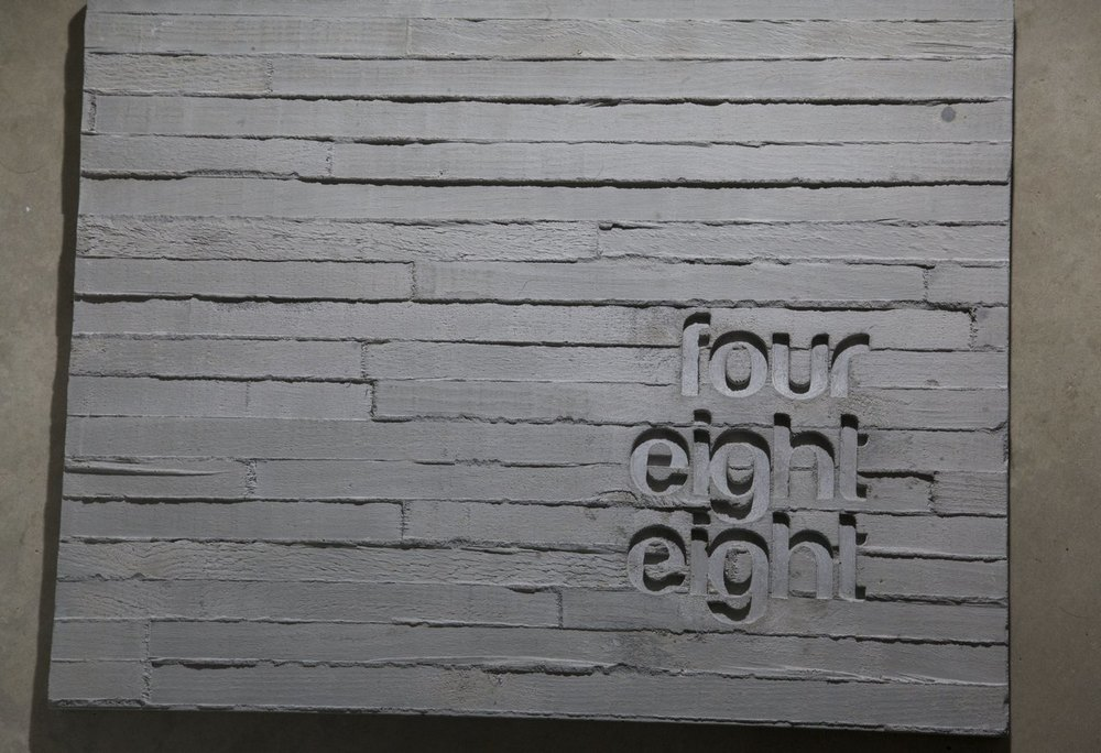 Debossed Text In Gray Shuttered Wood Concrete Sign