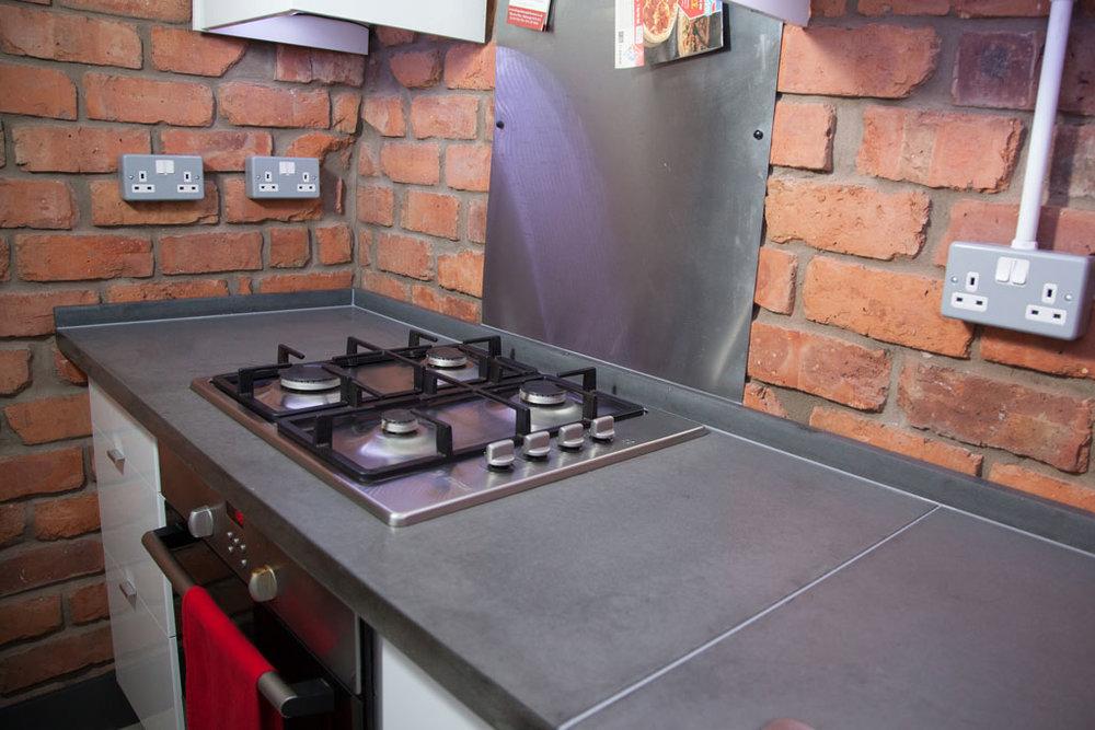 Gray Concrete Worktop in small kitchen
