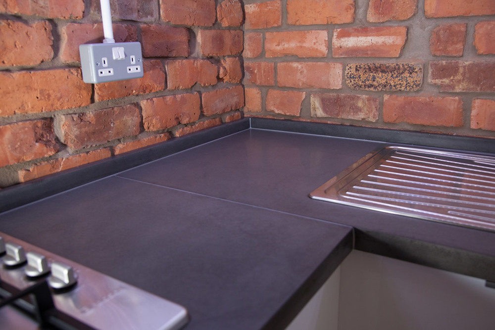 Concrete worktop with Exposed Brick Wall