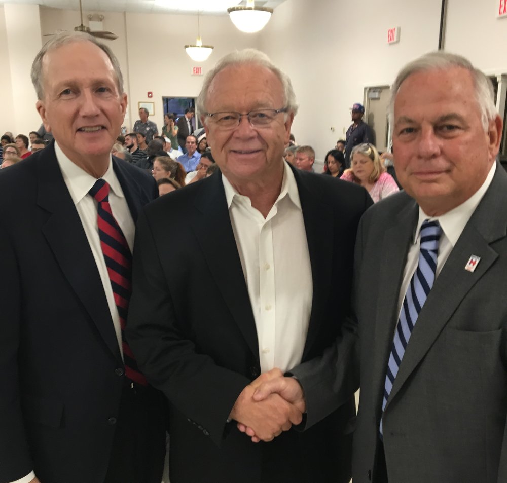 Harris County Attorney Vince Ryan (left) and Congressman Gene Green (right) welcome EPA Regional Administrator Ron Curry to Highlands for a hearing on the plan to clean up the San Jacinto River Waste Pits.